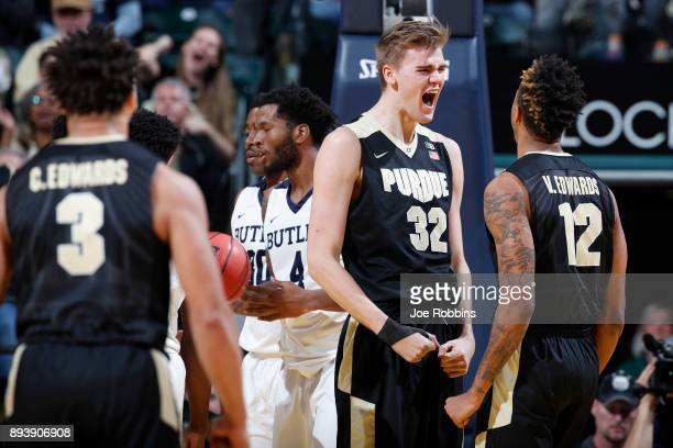 Matt Haarms and Vincent Edwards of the Purdue Boilermakers celebrate against the Butler Bulldogs in the second half of the Crossroads Classic at...