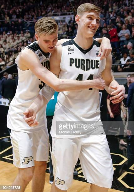 Matt Haarms hugs Isaac Haas of the Purdue Boilermakers following the game against the Minnesota Golden Gophers at Mackey Arena on February 25 2018 in...