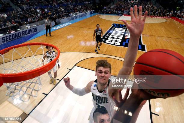 Matt Haarms of the Purdue Boilermakers blocks a shot against the Villanova Wildcats in the second half during the second round of the 2019 NCAA Men's...
