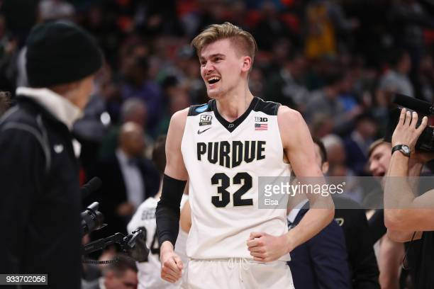 Matt Haarms of the Purdue Boilermakers celebrates defeating the Butler Bulldogs 76-73 in the second round of the 2018 NCAA Men's Basketball...