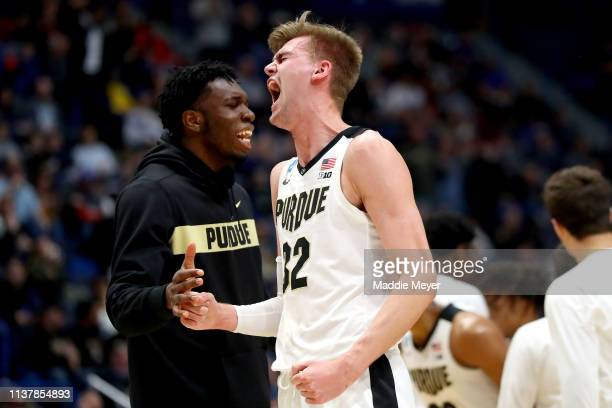 Matt Haarms of the Purdue Boilermakers celebrates his teams lead in the second half against the Villanova Wildcats during the second round of the...