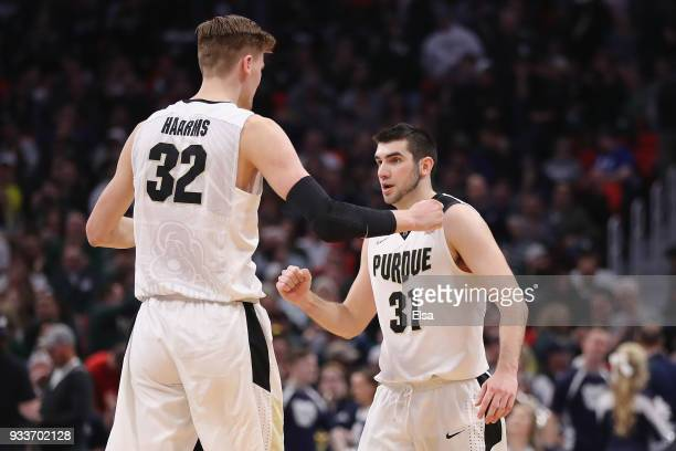 Matt Haarms of the Purdue Boilermakers celebrates with Dakota Mathias after defeating the Butler Bulldogs 7673 in the second round of the 2018 NCAA...
