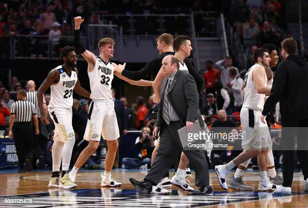 Matt Haarms of the Purdue Boilermakers celebrates with teammates after defeating the Butler Bulldogs 7673 in the second round of the 2018 NCAA Men's...