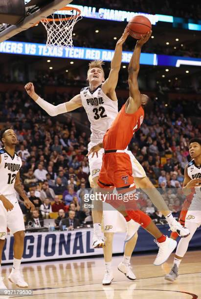 Matt Haarms of the Purdue Boilermakers defends a shot by Keenan Evans of the Texas Tech Red Raiders during the first half in the 2018 NCAA Men's...