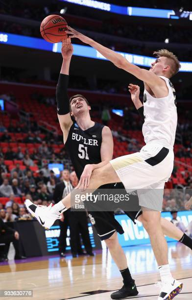 Matt Haarms of the Purdue Boilermakers defends a shot by Nate Fowler of the Butler Bulldogs during the first half in the second round of the 2018...