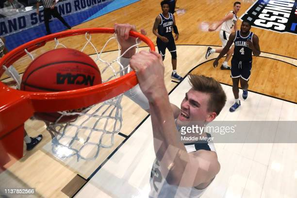Matt Haarms of the Purdue Boilermakers dunks the ball against the Villanova Wildcats in the first half during the second round of the 2019 NCAA Men's...