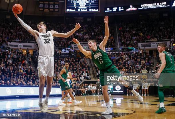 Matt Haarms of the Purdue Boilermakers reaches for the ball as Ben Vander Plas of the Ohio Bobcats defends at Mackey Arena on December 20 2018 in...