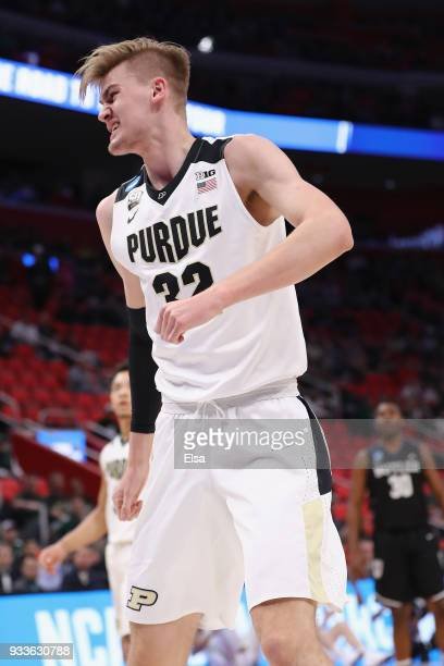 Matt Haarms of the Purdue Boilermakers reacts after blocking a shot by Nate Fowler of the Butler Bulldogs during the first half in the second round...