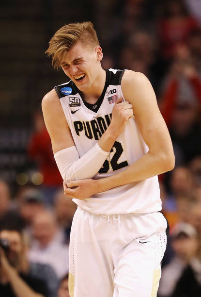 Matt Haarms of the Purdue Boilermakers reacts after suffering an injury during the first half against the Texas Tech Red Raiders in the 2018 NCAA...