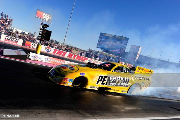 Matt Hagan Don Schumacher Racing Dodge Charger NHRA Funny Car does a burnout in the third round of qualifying for the 17th Annual Toyota Nationals...