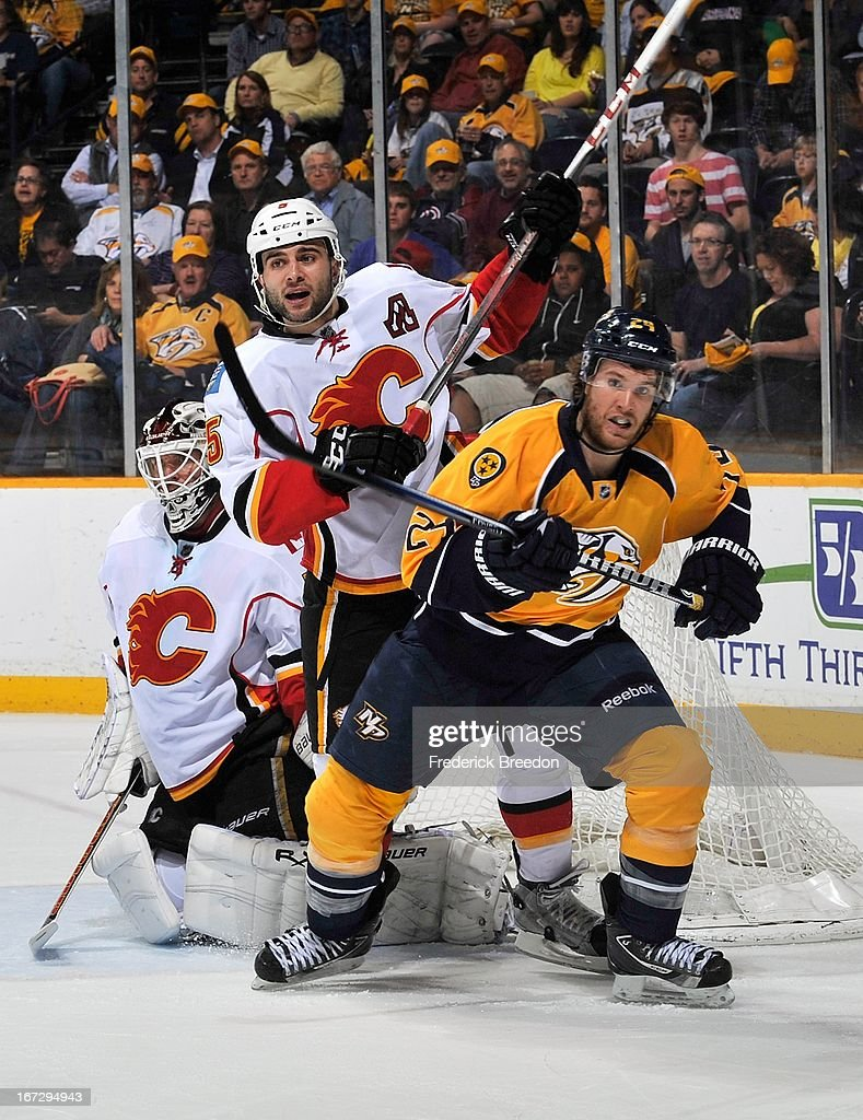 Matt Halischuk #24 of the Nashville Predators skates against Mark Giordano #5 of the Calgary Flames at the Bridgestone Arena on April 23, 2013 in Nashville, Tennessee.