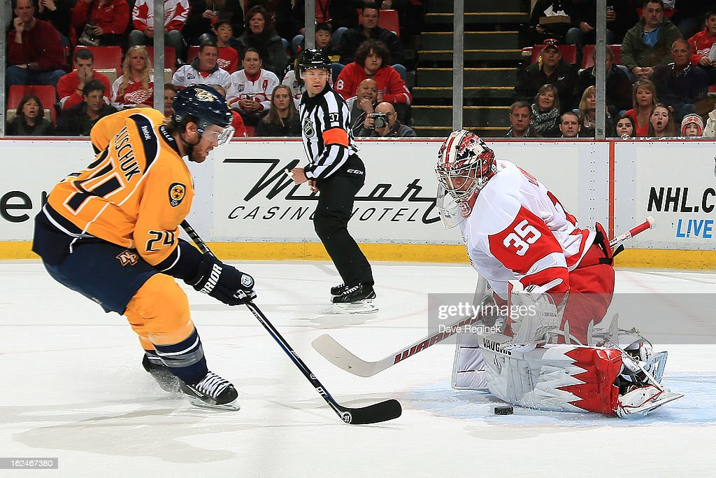 Matt Halishuk #24 of the Nashville Predators shoots a puck on Jimmy Howard #35 of the Detroit Red Wings at Joe Louis Arena on February 23, 2013 in Detroit, Michigan.