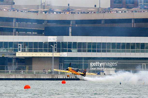 Matt Hall of Australia clips the water but pulls away safely on the Detroit River during the Red Bull Air Race Qualifying on June 5, 2010 in Windsor,...