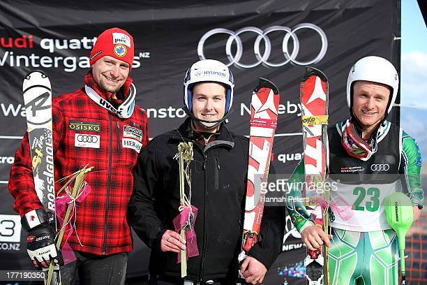 Matt Hallat of Canada Adam Hall of New Zealand and Mitchell Gourley of Australia pose on the podium after the Mens Slalom Standing race during the...