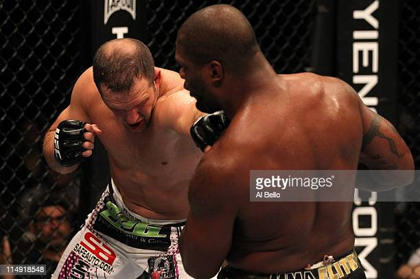"""Matt Hamill punches Quinton """"Rampage"""" Jackson during their light heavyweight fight at UFC 130 at the MGM Grand Garden Arena on May 28, 2011 in Las..."""