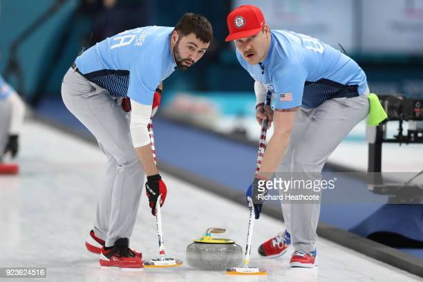 Matt Hamilton and John Landsteiner of the United States deliver a stone against Sweden during the Curling Men's Gold Medal game on day fifteen of the...