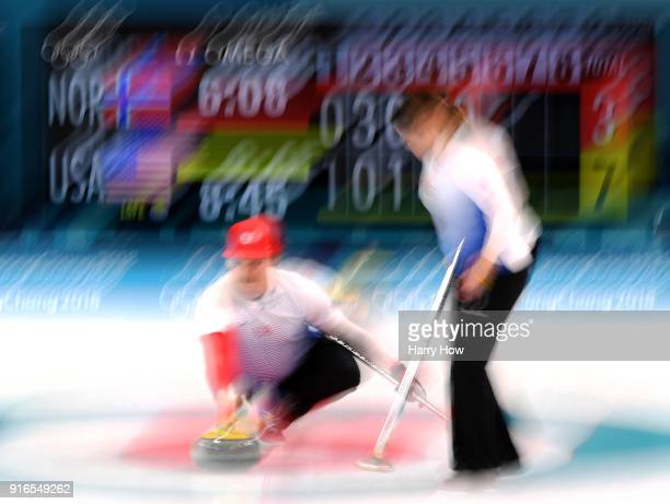 Matt Hamilton of the United States throws a rock with Becca Hamilton during a 103 win over Norway in the Curling Mixed Doubles Round Robin match on...