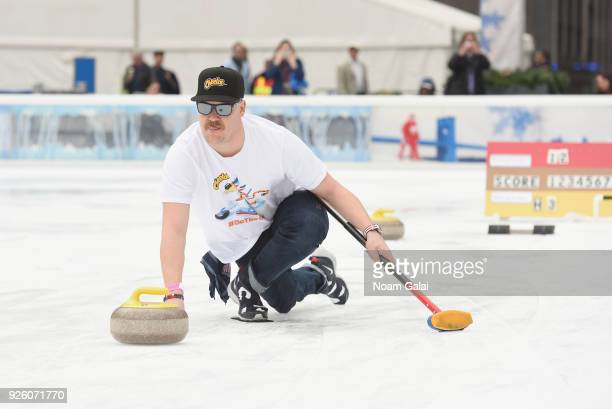Matt Hamilton of the USA men's curling team joined Cheetos on Thursday to demonstrate to fans how to curl at a curling event at the Bank of America...