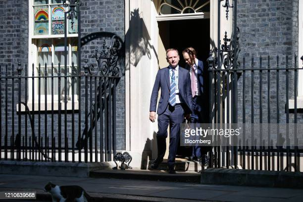 Matt Hancock UK health secretary right and Simon Stevens chief executive officer of the National Health Service depart from number 10 Downing Street...
