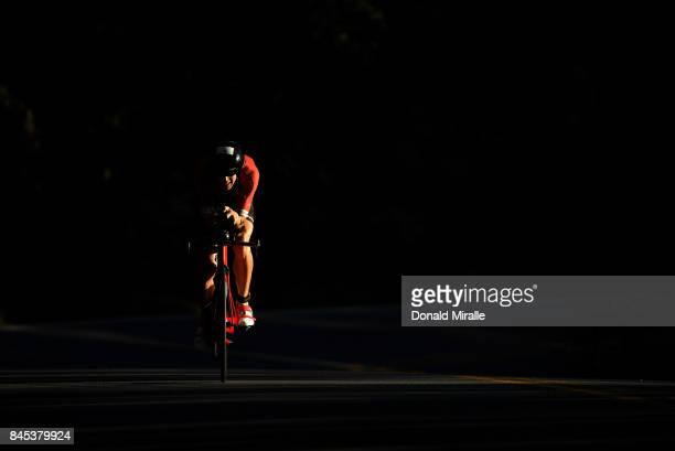 Matt Hanson bikes through the shadows during the Men's IRONMAN 703 St World Championships on September 10 2017 in Chattanooga Tennessee