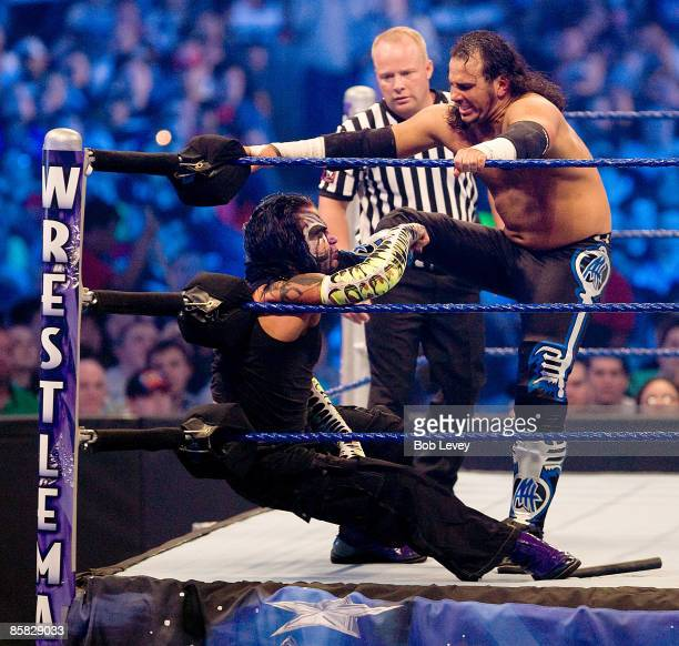 Matt Hardy puts a boot to the face of brother Jeff Hardy during an extreme rules match at WrestleMania 25 >> at the Reliant Stadium on April 5 2009...