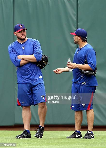 Matt Harrison and Geovany Soto of the Texas Rangers talk in centerfield before the start of the game against the Milwaukee Brewers at Rangers...