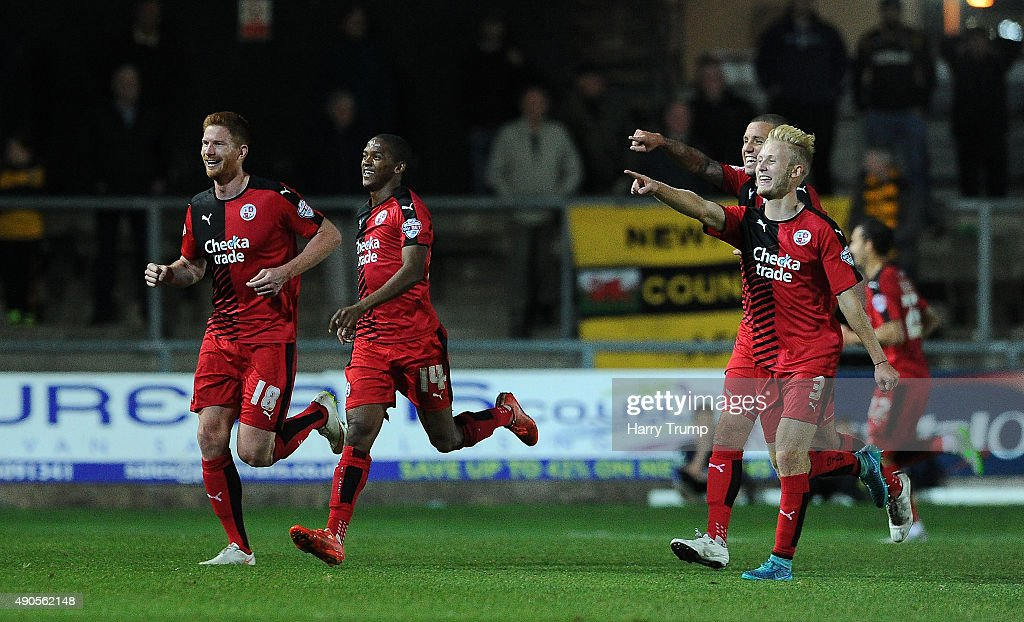 Matt Harrold of Crawley Town (far left) celebrates his side's third goal during the Sky Bet League Two match between Newport County and Crawley Town at Rodney Parade on September 29, 2015 in Newport, Wales.