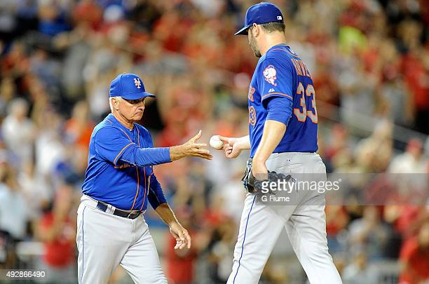 Matt Harvey of the New York Mets is taken out of the game by manager Terry Collins against the Washington Nationals at Nationals Park on September 8...