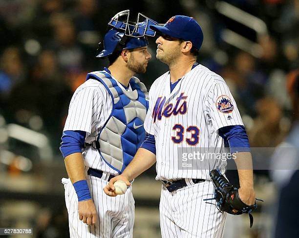 Matt Harvey of the New York Mets reacts as he is pulled from the game in the sixth inning against the Atlanta Braves as teammate Kevin Plawecki looks...