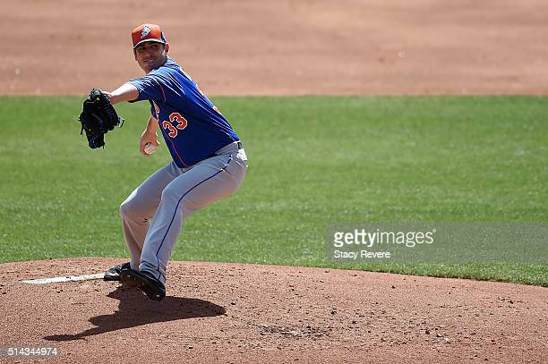 Matt Harvey of the New York Mets throws a pitch during the second inning of a spring training game against the Atlanta Braves at Champion Stadium on...