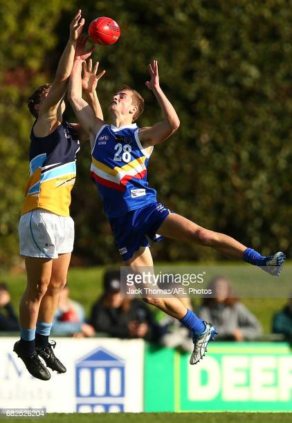 Matt Harvey of the Pioneers and Brent Bredin of the Ranges compete for the ball during the round seven TAC Cup match between the Eastern Ranges and...