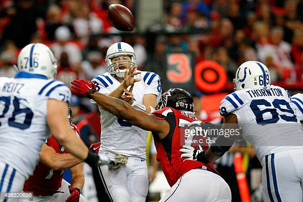 Matt Hasselbeck of the Indianapolis Colts is pressured by Ra'Shede Hageman of the Atlanta Falcons during the second half at the Georgia Dome on...