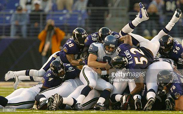 Matt Hasselbeck of the Seattle Seahawks is stopped on fourth down by Gary Baxter, Cornell Brown, Ray Lewis and the Baltimore Ravens defense which set...
