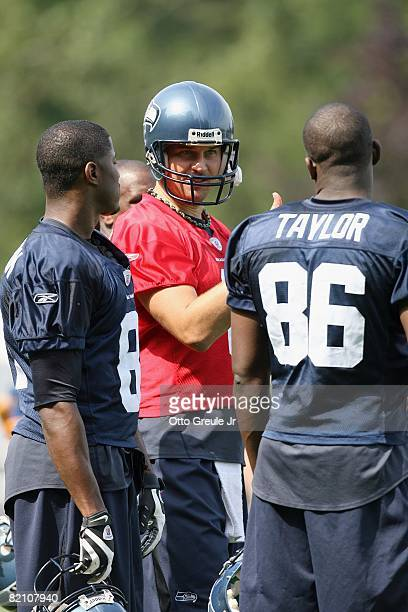 Matt Hasselbeck of the Seattle Seahawks talks with Courtney Taylor during training camp at the Seahawks Training Facility on July 25, 2008 in...