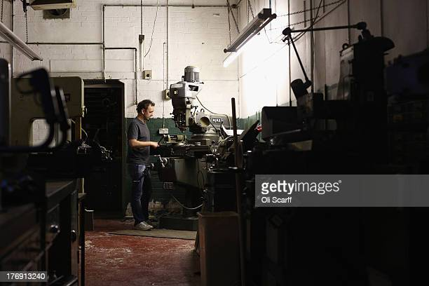eac65d6b047 Matt Havercroft an employee at Savile Row creates a pair of spectacles in  their factory in. ED. Editorial use only. An antique display board of NHS  ...