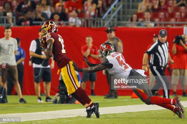 Matt Hazel of the Redskins taps his toes as he makes a catch in front of the Buccaneers linebacker Kendell Beckwith during the NFL Preseason game...