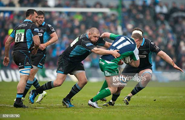 Matt Healy of Connacht tackled by Gordon Reid and Jonny Gray of Glasgow during the Guinness PRO12 rugby match between Connacht Rugby and Glasgow...