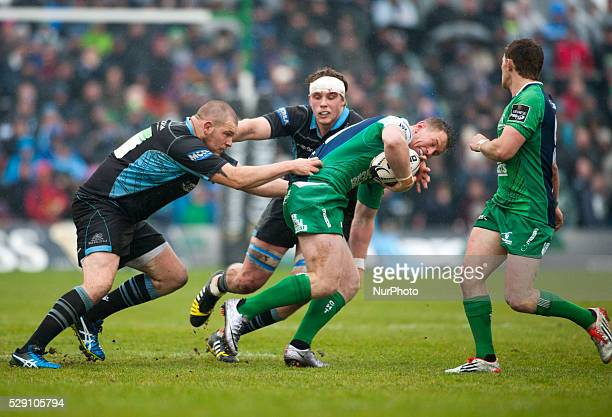Matt Healy of Connacht tackled by Jonny Gray and Gordon Reid of Glasgow during the Guinness PRO12 rugby match between Connacht Rugby and Glasgow...