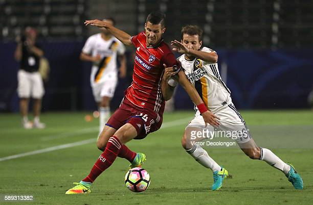 Matt Hedges of FC Dallas and Mike Magee of the Los Angeles Galaxy vie for the ball during the semifinal of the 2016 US Open Cup at StubHub Center on...