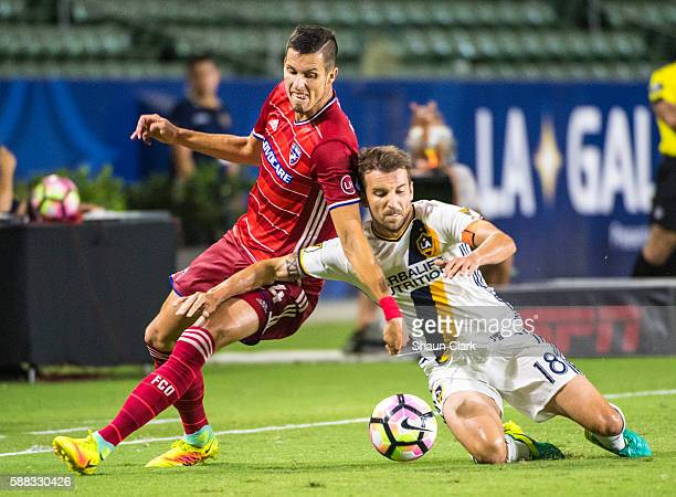 Matt Hedges of FC Dallas battles Mike Magee of Los Angeles Galaxy during Los Angeles Galaxy's 2016 US Open Cup Semifinal match against FC Dallas at...