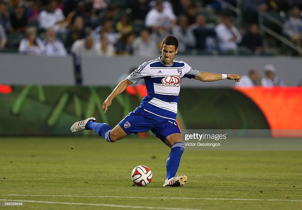 Matt Hedges #24 of FC Dallas crosses in the first half during the MLS match against the Los Angeles Galaxy at StubHub Center on May 21, 2014 in Los Angeles, California. The Galaxy defeated FC Dallas 2-1.