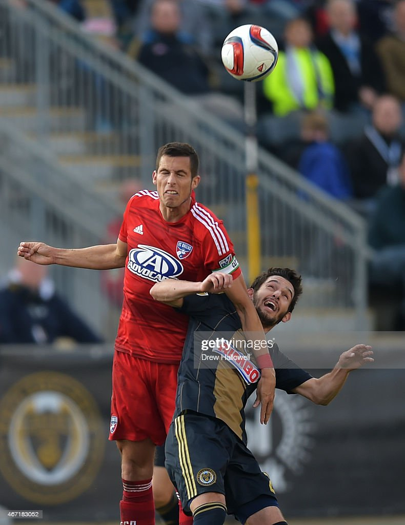 Matt Hedges #24 of FC Dallas heads the ball away from Zach Pfeffer #27 of Philadelphia Union at PPL Park on March 21, 2015 in Chester, Pennsylvania.