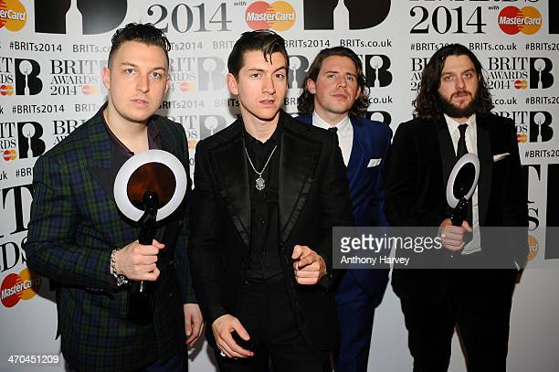 Matt Helders Alex Turner Jaime Cook and Nick O'Malley of Arctic Monkeys winners of the British Group and MasterCard British Album of the Year and...