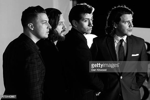 Matt Helders Nick O'Malley singer Alex Turner and Jamie Cook of Arctic Monkeys attend The BRIT Awards 2014 at 02 Arena on February 19 2014 in London...