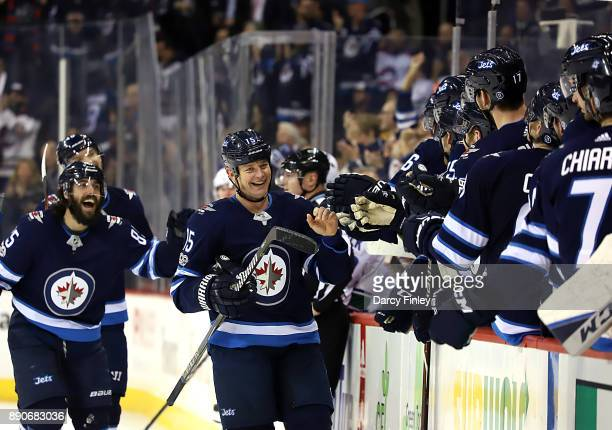 Matt Hendricks and Mathieu Perreault of the Winnipeg Jets are all smiles as they celebrate a third period goal against the Vancouver Canucks with...