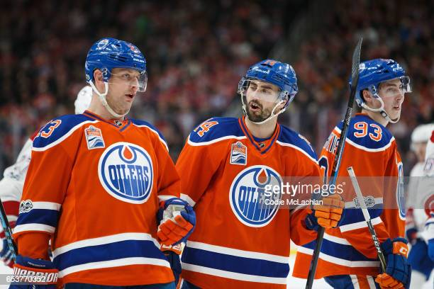 Matt Hendricks Jordan Eberle and Ryan NugentHopkins of the Edmonton Oilers strategize during a break in play against the Montreal Canadiens on March...