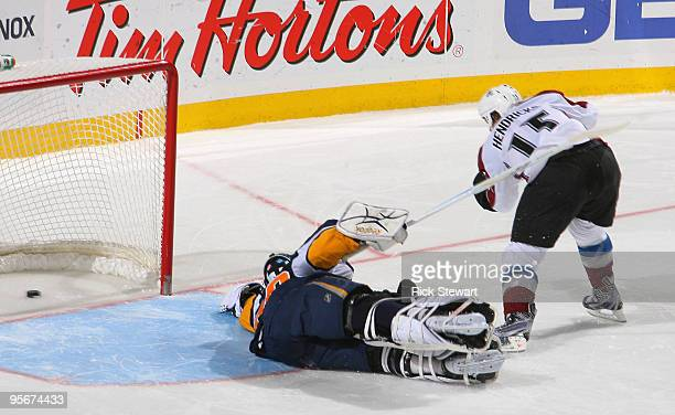 Matt Hendricks of the Colorado Avalanche scores the game winning goal in a shootout against Patrick Lalime of the Buffalo Sabres at HSBC Arena on...