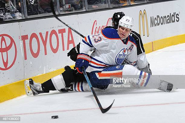 Matt Hendricks of the Edmonton Oilers battles for the puck during a game against the Los Angeles Kings at STAPLES Center on November 14 2015 in Los...