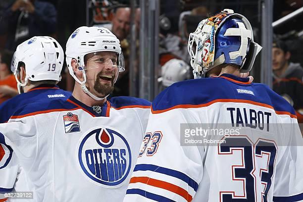 Matt Hendricks of the Edmonton Oilers congratulates Cam Talbot for his shutout win against the Anaheim Ducks on January 25 2017 at Honda Center in...