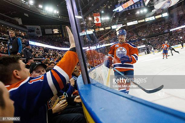 Matt Hendricks of the Edmonton Oilers has some fun with fans during a game against the Vancouver Canucks on March 18 2016 at Rexall Place in Edmonton...